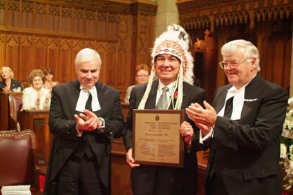 Willie Littlechild receiving the 2006 Distinguished Service Award from  the Speaker of the Senate, the Honourable Noël Kinsella, Senator (right) and  the Speaker of the House of Commons, the Honourable Peter Milliken, M.P. (left).