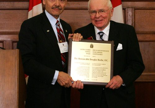 The Honourable Don Boudria, Acting Chair of the Canadian Association of Former Parliamentarians and 2009 Distinguished Service Award recipient, the Honourable Douglas Roche.